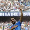 Photo - Napoli's Gonzalo Higuain celebrates after scoring during a Serie A soccer match between Napoli and Torino, at the San Paolo stadium in Naples, Italy, Sunday, Oct. 27, 2013. (AP Photo/Salvatore Laporta)