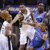 Oklahoma City\'s Russell Westbrook (0) is fouled by San Antonio\'s Tim Duncan (21) during Game 5 of the Western Conference Finals in the NBA playoffs between the Oklahoma City Thunder and the San Antonio Spurs at the AT&T Center in San Antonio, Thursday, May 29, 2014. Photo by Sarah Phipps, The Oklahoman