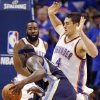 Oklahoma City\'s Nick Collison (4) defends Zach Randolph (50) of Memphis as James Harden (13) of Oklahoma City looks on in the first half during game 7 of the NBA basketball Western Conference semifinals between the Memphis Grizzlies and the Oklahoma City Thunder at the OKC Arena in Oklahoma City, Sunday, May 15, 2011. Photo by Nate Billings, The Oklahoman