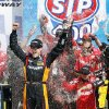 Matt Kenseth (20) celebrates in Victory Lane after winning the NASCAR Sprint Cup Series auto race at Kansas Speedway in Kansas City, Kan., Sunday, April 21, 2013. (AP Photo/Orlin Wagner)