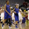Kansas\' Carolyn Davis (21) and Angel Goodrich (3) walk back to the bench at the end of an NCAA college basketball game against Iowa State in the Big 12 women\'s tournament on Saturday, March 9, 2013, in Dallas. Iowa State won 77-62. (AP Photo/Tony Gutierrez)