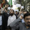 Iranian protestors chant slogans during a demonstration against a film ridiculing Islam\'s Prophet Muhammad, in front of Swiss Embassy in Tehran, which represents US interests in Iran, Thursday, Sept. 13, 2012. About 50 protesters gathered in Tehran outside the Swiss Embassy, which looks after U.S. diplomatic interests in Iran, shouting ``Death to America\'\' and condemning the film. The embassy is heavily guarded by Iranian riot police and there are no reports of violence. (AP Photo/Vahid Salemi) ORG XMIT: VAH101
