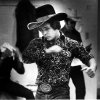 Photo - DONNIE GAY / NATIONAL FINALS RODEO / NFR: Swinging like a boxer - Bull rider - #10 Don Gay warms up before his next rider - Gay has won over a quarter of a million riding bulls.  Donnie Gay says a bull rider has to deal with pain. STAFF PHOTO BY MONTY REED (Original photo published 12/09/1978)ORG XMIT: 0811282017250905
