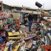 Warren Waltz, of Love\'s, examines tornado damage to the store at Choctaw Road and Interstate 40 east of Oklahoma City today. AP Photo