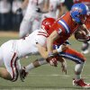 OCS\' Will McKinnis is brought down by Davis\' Alec Hetherington during the Class 2A high school football championships between Davis and Oklahoma Christian School at Boone Pickens Stadium in Stillwater, Okla., Saturday,Dec. 8, 2012. Photo by Sarah Phipps, The Oklahoman