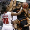 Photo - Oklahoma State's Toni Young (15) tries to get past Texas Tech's Chynna Brown (00) during the Big 12 tournament women's college basketball game between Oklahoma State University and Texas Tech University at American Airlines Arena in Dallas, Saturday, March 9, 2012. Oklahoma State won 59-54.  Photo by Bryan Terry, The Oklahoman