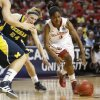 Oklahoma\'s Aaryn Ellenberg (3) goes past Michigan\'s Jenny Ryan (24) during a first round game of the NCAA women\'s basketball tournament between the University of Oklahoma Sooners and the Michigan Wolverines at Lloyd Noble Center in Norman, Okla., Sunday, March 18, 2012. Oklahoma won 88-67. Photo by Bryan Terry, The Oklahoman