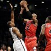 Brooklyn Nets\' Jason Collins, left, defends Chicago Bulls\' Taj Gibson during the second half of an NBA basketball game Monday, March 3, 2014, in New York. The Nets won 96-80. (AP Photo/Seth Wenig)