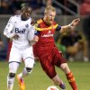 Photo - Vancouver Whitecaps' Darren Mattocks, left, and Real Salt Lake's Nat Borchers go for the ball during an MLS soccer game in Sandy, Utah, Saturday, April 26, 2014. (AP Photo/Deseret News, Kristin Murphy) SALT LAKE TRIBUNE OUT; MAGAZINES OUT; MANDATORY CREDIT