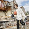 TORNADO / STORM / DAMAGE: Hazel Wright gather items from the damage at her daughter\'s home in the Oak Tree housing addition on Wednesday, Feb. 11, 2009, after a tornado hit the area on Tuesday in Edmond, Okla. PHOTO BY CHRIS LANDSBERGER, THE OKLAHOMAN ORG XMIT: KOD