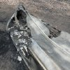 The bottom of an aluminum fishing boat is melted after being destroyed by the High Park Fire in the Glacier View residential area near Livermore, Colo., on Monday, July 2, 2012. The last evacuees from the fire in have been allowed to return home as crews fully contained the136-square-mile wildfire that killed one resident and destroyed 259 houses. (AP Photo/Ed Andrieski) ORG XMIT: COEA109