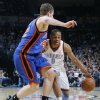 Oklahoma City\'s Russell Westbrook (0) dribbles as David Lee (42) of New York defends during the NBA basketball game between the Oklahoma City Thunder and the New York Knicks at the Ford Center in Oklahoma City, January 11, 2010. Photo by Nate Billings, The Oklahoman