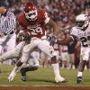 Oklahoma\'s Chris Brown (29) makes his way into the endzone past Texas A&M\'s Jordan Pugh (25) during the second half of the college football game between the University of Oklahoma Sooners (OU) and the Texas A&M Aggies at Gaylord Family-Memorial Stadium on Saturday, Nov. 14, 2009, in Norman, Okla. Photo by Chris Landsberger, The Oklahoman