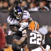 Photo - Baltimore Ravens wide receiver Marlon Brown (14) makes a catch for a first down against Cleveland Browns cornerback Buster Skrine (22) in the fourth quarter of an NFL football game Sunday, Nov. 3, 2013. (AP Photo/David Richard)