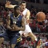 Photo - Texas Tech's Dejan Kravic defends West Virginia's Juwan Staten during an NCAA college basketball game in Lubbock, Texas, Saturday, Feb. 2, 2013. (AP Photo/Lubbock Avalanche-Journal,Stephen Spillman)