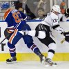 Los Angeles Kings\' Kyle Clifford (13) misses the hit on Edmonton Oilers\' Ales Hemsky during the first period of their NHL hockey game, Tuesday, Feb. 19, 2013, in Edmonton, Alberta. (AP Photo/The Canadian Press, Jason Franson)