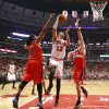 Photo - Chicago Bulls center Joakim Noah (13) shoots between Washington Wizards forward Nene Hilario (42) and Marcin Gortat during the first half of Game 2 in an opening-round NBA basketball playoff series Tuesday, April 22, 2014, in Chicago. (AP Photo/Charles Rex Arbogast)