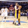 Lakers\' Pau Gasol (16) and Kobe Bryant (24) celebrate the Lakers\' win as Oklahoma City\'s Nick Collison (4) and Thabo Sefolosha (2) walk off the court during the NBA basketball game between the Oklahoma City Thunder and the Los Angeles Lakers, Sunday, Feb. 27, 2011, at the Oklahoma City Arena.Photo by Sarah Phipps, The Oklahoman