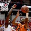 Oklahoma State\'s Brian Williams (4) shoots over Iowa State forward Anthony Booker during the first half of an NCAA college basketball game, Wednesday, March 6, 2013, in Ames, Iowa. (AP Photo/Justin Hayworth)