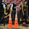Photo - Maryland's Alyssa Thomas, left, runs a drill during practice at the NCAA women's college basketball tournament Saturday, March 22, 2014, in College Park, Md. Maryland plays Army in a first-round game on Sunday. (AP Photo/Gail Burton)