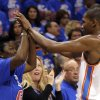 Oklahoma City\'s Kevin Durant (35) high fives his mom Wanda Pratt during Game 5 in the second round of the NBA playoffs between the Oklahoma City Thunder and the L.A. Lakers at Chesapeake Energy Arena in Oklahoma City, Monday, May 21, 2012. Photo by Sarah Phipps, The Oklahoman