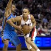 Photo - Portland Trail Blazers guard Jerryd Bayless, right, drives to the basket against Oklahoma City Thunder guard Earl Watson during the first half of an NBA basketball game in Portland, Ore., Wednesday, Feb. 11, 2009. (AP Photo/Don Ryan) ORG XMIT: ORDR104