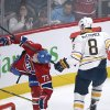 Buffalo Sabres\' Cody McCormick (8) gets his stick up on Montreal Canadiens\' Brendan Gallagher during the second period of an NHL hockey game in Montreal, Saturday ,Feb. 2, 2013. (AP Photo/The Canadian Press, Graham Hughes)