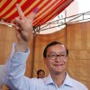 FILE - IN this April 1, 2007 file photo, Sam Rainsy, the leader of Cambodia\'s opposition Sam Rainsy Party, shows off a V-sign after casting his ballot at a polling station in Phnom Penh, Cambodia. Thousands of cheering supporters greeted Cambodian opposition leader Sam Rainsy as he returned from self-imposed exile Friday, July 19, 2013 to spearhead his party\'s election campaign against well-entrenched Prime Minister Hun Sen. (AP Photo/Heng Sinith, File)