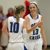 Edmond Deer Creek\'s Whitney Jones (13) and Alexa Adair (10) smile at one another following a run during the first quarter of their first round 5A girls playoff game against Collinsville, in Catoosa, on Thursday, March 7, 2013. CORY YOUNG/Tulsa World