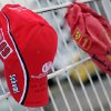 Schumacher fan caps are attached on the fence at the Michael Schumacher Cart Center in his home town Kerpen, western Germany, Thiursday, Jan. 2, 2014. The Formula One record world champion is still in a coma after his skiing accident in France. Handwriting on the left cap reads