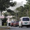 Cars wait to pass the security check at the CIMEQ hospital in Havana, Cuba, Wednesday, Jan. 16, 2013. It\'s a blocky, lobster-colored building surrounded by a lush canopy of trees near the rumored home of Cuban revolutionary icon Fidel Castro. Somewhere inside, as best as can be determined, Venezuelan President Hugo Chavez is fighting for his life. CIMEQ hospital's well-earned reputation for guaranteeing the privacy of its elite clientele makes it the perfect place for the Venezuelan leader, who is bent on maintaining near total secrecy on his battle against a cancer somewhere in the pelvic region. (AP Photo/Franklin Reyes)