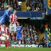 Photo - Chelsea's Fernando Torres, top left, rises above the Stoke City's defense to head the ball towards goal  during their English Premier League soccer match between Chelsea and Stoke City at Stamford Bridge stadium in London, Saturday, April, 5, 2014. (AP Photo/Alastair Grant)