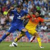 Photo -   FC Barcelona's Cesc Fabregas, right, vies for the ball with Getafe's Lopo Garcia during a Spanish La Liga soccer match at the Coliseum Alfonso Perez stadium in Getafe, near Madrid, Spain, Saturday, Sept. 15, 2012. (AP Photo/Andres Kudacki)