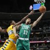 Boston Celtics guard Courtney Lee, right, drives the lane for a basket past Denver Nuggets forward Kenneth Faried during the first quarter of an NBA basketball game in Denver on Tuesday, Feb. 19, 2013. (AP Photo/David Zalubowski)