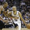 San Antonio Spurs\' Tony Parker drives as Miami Heat\'s Chris Bosh defends during the first half at Game 4 of the NBA Finals basketball series, Thursday, June 13, 2013, in San Antonio. (AP Photo/Eric Gay)