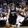 Minnesota Timberwolves guard Luke Ridnour, left, drives the baseline against Portland Trail Blazers guard Damian Lillard during the first quarter of an NBA basketball game in Portland, Ore., Saturday, March 2, 2013. (AP Photo/Don Ryan)