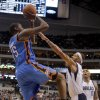 Oklahoma City\'s Kevin Durant (35) shoots over Dallas\' Delonte West during the pre season NBA game between the Dallas Mavericks and the Oklahoma City Thunder at the American Airlines Center in Dallas, Sunday, Dec. 18, 2011. Photo by Sarah Phipps, The Oklahoman