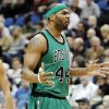 Photo - Boston Celtics forward Chris Wilcox (44) reacts after being called for a foul against the Minnesota Timberwolves during the first half of an NBA basketball game Monday, April 1, 2013, in Minneapolis. (AP Photo/Genevieve Ross)