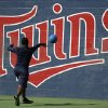 Photo - Minor league baseball player Randy Rosario works out with a ball in front of a Minnesota Twins logo at the Twins' spring  training baseball facility, Friday, Feb. 21, 2014, in Fort Myers, Fla. (AP Photo/Steven Senne)
