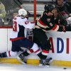 Photo - Ottawa Senators' Jared Cowan (2) is checked by Washington Capitals' Tom Wilson (43) during second period NHL hockey action in Ottawa, Ontario, on Monday, Dec. 30, 2013. (AP Photo/The Canadian Press, Fred Chartrand)