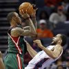 Milwaukee Bucks\' Monta Ellis, left, runs into Charlotte Bobcats\' Jeffery Taylor, right, during the first half of an NBA basketball game in Charlotte, N.C., Monday, Nov. 19, 2012. Ellis was called for a foul on the play. (AP Photo/Chuck Burton)