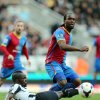 Photo - Newcastle United's Chieck Tiote, left, vies for the ball with Crystal Palace's Camerone Jerome, right, during their English Premier League soccer match at St James' Park, Newcastle, England, Saturday, March 22, 2014. (AP Photo/Scott Heppell)