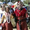 Medieval Fair Queen Phillipa, Debra Adams, and King Edward III, Cody Clark, take a walk Friday through Reaves Park in Norman.