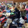 Kendall Kell, a Winslow Township teacher from Hammonton, and her daughters Kerstin, 11, left, and Shannon, 9, go over a list of families affected by Superstorm Sandy as they pick out clothes and supplies at Texas Avenue School in Atlantic City, N.J. Thursday, Nov., 8, 2012. (AP Photo/The Press of Atlantic City, Danny Drake) MANDATORY CREDIT