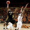 J.T. Tiller of Missouri goes to the basket past OSU\'s Obi Muonelo during the Big 12 college basketball game between Oklahoma State and Missouri at Gallagher-Iba Arena in Stillwater, Okla., Wednesday, Jan. 21, 2009. PHOTO BY BRYAN TERRY, THE OKLAHOMAN