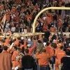 OSU fans carry a goal post off the field after the Cowboys beat OU, 41-26, during the Bedlam college football game in Stillwater, Okla. Oct. 24, 1998. Photo by Doug Hoke, The Oklahoman