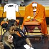 Coach Kurt Budkey\'s orange blazer hangs from a seat on the sideline during the memorial service for Oklahoma State head basketball coach Kurt Budke and assistant coach Miranda Serna at Gallagher-Iba Arena on Monday, Nov. 21, 2011 in Stillwater, Okla. The two were killed in a plane crash along with former state senator Olin Branstetter and his wife Paula while on a recruiting trip in central Arkansas last Thursday. Photo by Chris Landsberger, The Oklahoman
