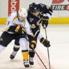 Photo - St. Louis Blues' David Backes (42) and Nashville Predators' Gabriel Bourque (57) reach for the puck during the second period of an NHL hockey game Saturday, Feb. 1, 2014, in St. Louis. (AP Photo/Bill Boyce)