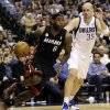 Photo - Miami Heat forward LeBron James (6) drives past Dallas Mavericks center Chris Kaman (35) during the first quarter of an NBA basketball game, Thursday, Dec. 20, 2012, Dallas. (AP Photo/LM Otero)
