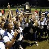 Southmoore players celebrate their 3-1 victory over Moore in the State 6A Softball Championship game on Saturday, Oct. 19, 2013 in Shawnee, Okla. Photo by Steve Sisney, The Oklahoman